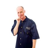 Policeman smiling with finger in mouth Stock Photography