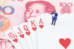 Policeman standing on the gamble card Royalty Free Stock Image