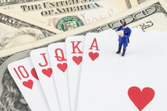 Policeman standing on the gamble card with US  dollar Stock Photo
