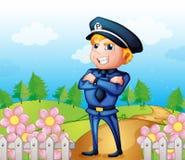 A policeman standing in the garden Royalty Free Stock Photos