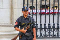 Policeman standing near Government Palace in Lima, Peru. Royalty Free Stock Images