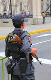 Policeman standing near Government Palace in Lima, Peru. Stock Photos