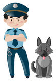Policeman standing with police dog Stock Photo