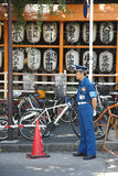 Policeman standing in street in Tokyo Royalty Free Stock Photos