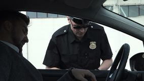 Policeman stopping a driver