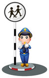 A policeman beside the street signage Stock Photos