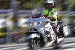 The policeman of Taiwan. TAIPEI,TAIWAN -October 20,2012:Unidentified policeman of Taiwan riding motorcycle - doing the traffic control for street parade of Stock Photo