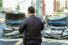 Policeman. A policeman takes notes after a traffic accident on Libertador Avenue in Buenos Aires (Argentina Stock Photography
