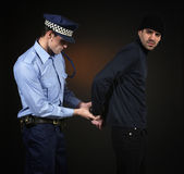 Policeman and thief. Robbery scene. Unaware officer that a crime is being comited Stock Images