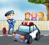 A policeman and the three girls outside the fence Stock Images