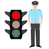 Policeman and traffic light Royalty Free Stock Photography