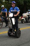 Policeman travels on a segway stock photos