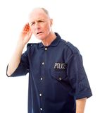 Policeman trying to listen Royalty Free Stock Image
