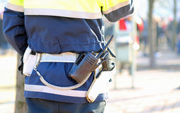 policeman in uniform with a radio transmitter and gun during a d Stock Images