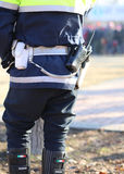 policeman in uniform with a radio transmitter and gun Royalty Free Stock Image