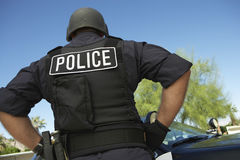 Policeman In Uniform Standing Against Car Stock Photography
