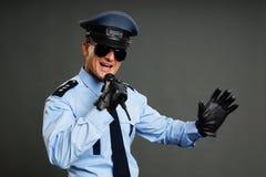 Policeman in uniform standing Stock Photo