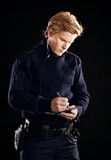 Policeman in uniform writing a ticket stock photos