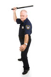 Policeman Using Night Stick. Police officer in aggressive posture, using his night stick.  Full body isolated on white Stock Image