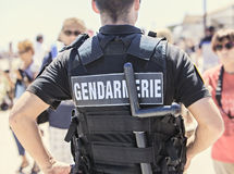 Policeman watching the crowd Stock Images