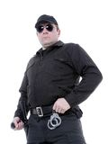 Policeman. Wearing black uniform and glasses standing confidently Stock Photos