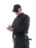 Policeman taking notes Stock Image
