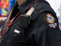Policeman wearing gay friendly straps pride Vancouver. Police officer on duty lgbt symbols concept acceptance diversity Royalty Free Stock Images