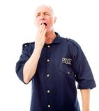 Policeman yawning Royalty Free Stock Photography