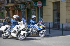 Policemans on police motorbikes Stock Photography