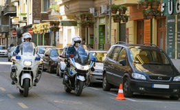 Policemans on police motorbikes Stock Images