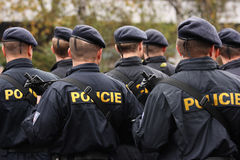 Policemen. Editorial photo: Back view of Czech police forces armed with sub-machine guns. Troops review in Prague, Czech Republic. 28th October 2008 Stock Image