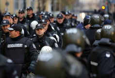 Policemen at an anti-government protest Stock Image