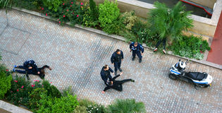 Policemen arresting Young People, France. Street scene in Levallois-Perret (Île-de-France, France) of policemen holding down suspects to the ground. October 19 royalty free stock photo