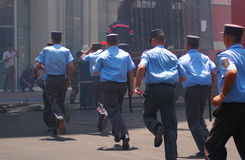 Policemen with batons. Running away stock images