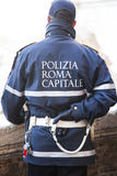 Policemen capital city of Rome while controlling the flow of tourists in front of the monument of the Trevi fountain