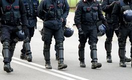 Policemen and carabinieri marching Royalty Free Stock Photo