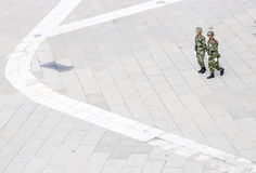 Policemen in China. Lhasa,China-Aug.26:Two policemen walks in the square outside the Potala Palace on Aug.26,2010 in Lhasa of Tibet of China Stock Image