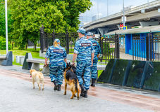 Policemen and dogs patrol the park near the Exhibition of Achievements of the National Economy. Cynologists at VDNKh. Russia, Moscow - July 12/2016: Policemen Stock Photo