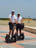 Policemen on duty patrolling seafront promenade on Segways. Torremolinos, Andalucia, Spain - June 27, 2016: Policemen on duty patrolling seafront promenade on Royalty Free Stock Photography