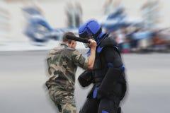 Policemen fighting Stock Photos