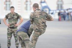 Policemen fighting Royalty Free Stock Photos