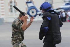 Policemen fighting Royalty Free Stock Image