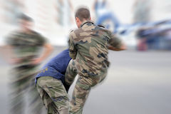 Policemen fighting Stock Photo