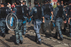 Policemen follow the Mayday parade in Milan, Italy Stock Images