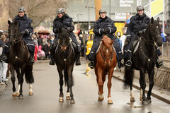 Policemen on horseback open Carnival parade, Stuttgart. STUTTGART, GERMANY - FEBRUARY 28: four policemen on horseback open the parade. Shot at  Carnival parade Royalty Free Stock Photography