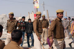 Policemen in India. Indian policemen control of the situation at the biggest festival in the world - Kumbh Mela, on January 26, 2013 in Allahabad, India. It is Stock Photography