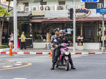 Policemen patroling the area on a scooter Royalty Free Stock Photography