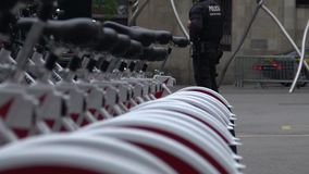 Policemen patrolling the city and providing security near bicycle parking. Stock footage stock video