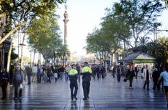 Policemen patrolling La Rambla street, Barcelona Royalty Free Stock Photography