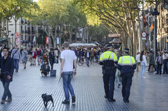 Policemen patrolling La Rambla street, Barcelona. Policemen patrolling in La Rambla street in Barcelona Stock Images